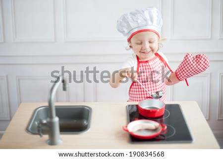 Cute little cook - stock photo