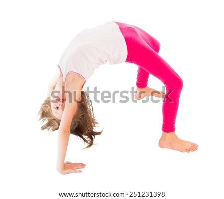 Cute little flexible girl doing bridge pose. - stock photo