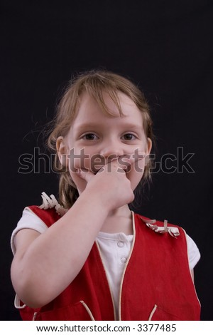 Cute little four year-old laughing in a red cowgirl outfit