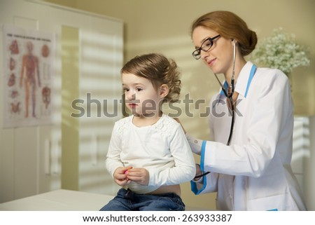 Cute little girl and doctor