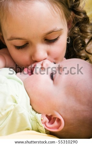 Cute little girl and her newborn sister