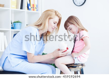 Cute little girl at doctor's office. Pediatrician with child