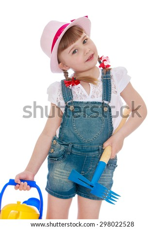 Cute little girl at my grandparents in the country working in the garden-Isolated on white background
