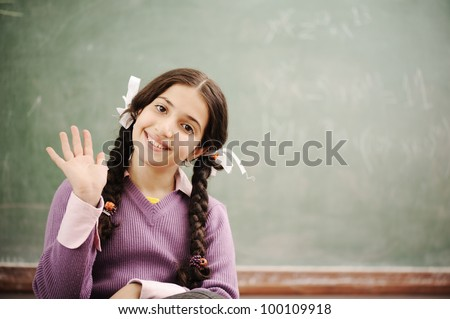 Cute little girl at school saying HI - stock photo