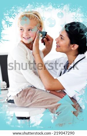 Cute little girl attending a medical checkup against christmas frame - stock photo