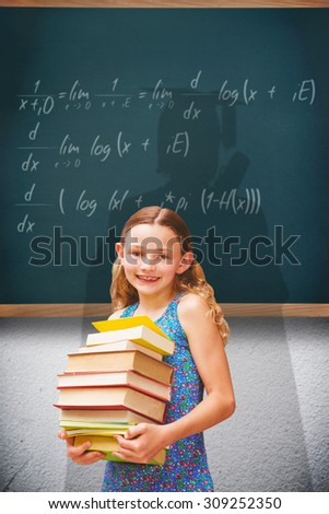 Cute little girl carrying books in library against teal, blue