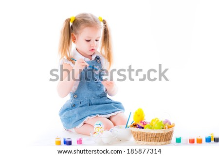 Cute little girl coloring easter eggs