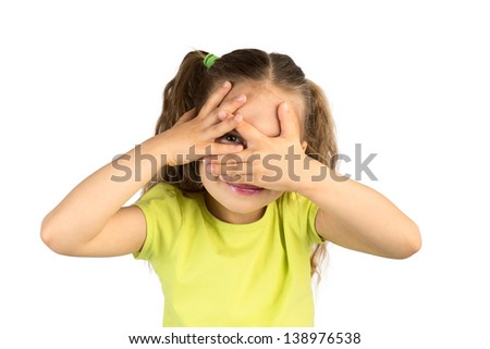 Cute Little Girl Covering Her Eyes While Watching Through the Gap in Fingers, Isolated
