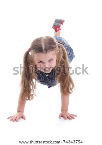 Cute little girl does gymnastics,  isolated on white background - stock photo