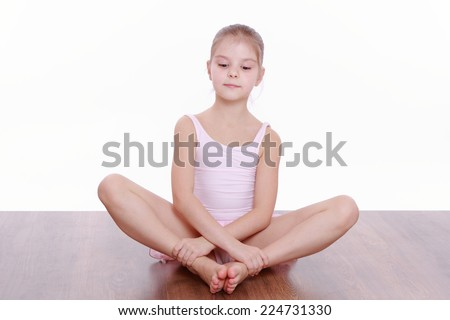 Cute little girl doing gymnastic - stock photo