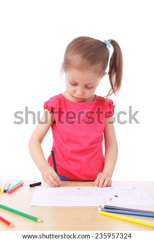 cute little girl drawing closeup - stock photo