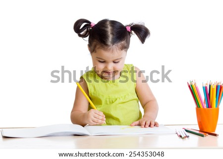 cute little girl drawing with colourful pencils - stock photo