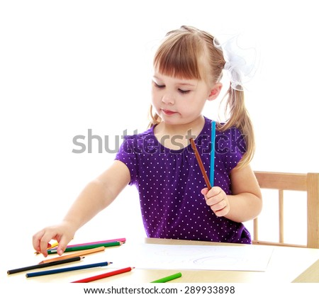 Cute little girl drawing with markers at the table - isolated on white background - stock photo