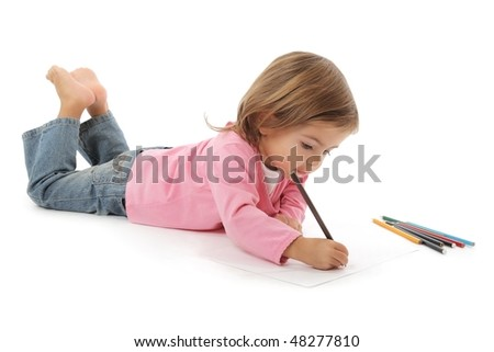 cute little girl drawing with pencils studio shot on white