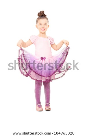 Cute little girl dressed up like ballerina isolated on white background