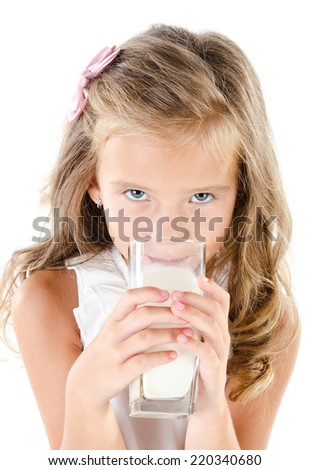 Cute little girl drinking milk isolated on a white background - stock photo