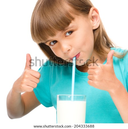 Cute little girl drinks milk and showing thumb up sign using both hands, isolated over white - stock photo