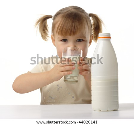 Cute little girl drinks milk, isolated over white - stock photo