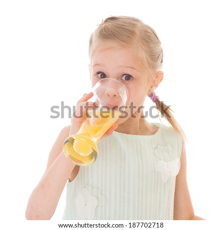 Cute little girl drinks orange juice, isolated over white