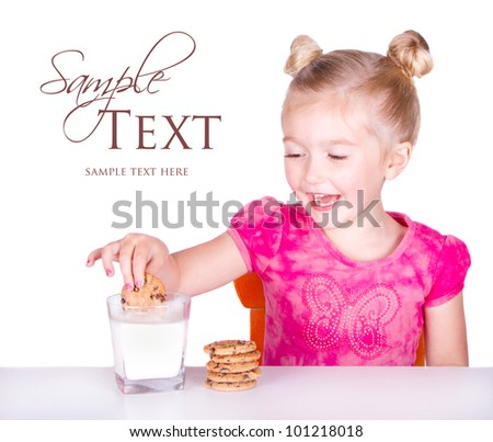 cute little girl dunking cookie in milk isolated on white background - stock photo