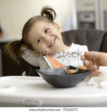 cute little girl eating - stock photo