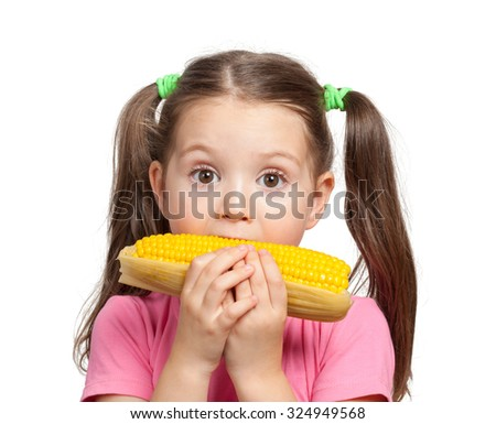 cute little girl eating corn - stock photo