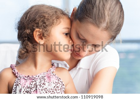 Cute little girl embracing with her mother - stock photo