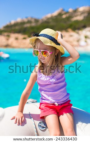 Cute little girl enjoying sailing on boat during summer vacation - stock photo