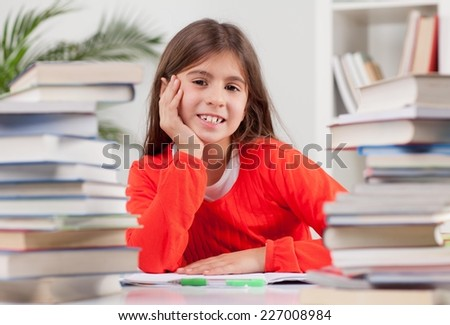 Cute little girl fell a sleep while doing her homework. Elementary age. - stock photo