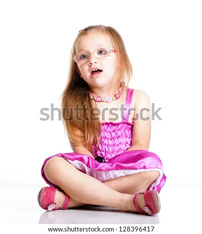 cute little girl glasses sitting on floor studio shot isolated on white background