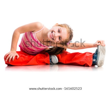 cute little girl goes in for sports on a white background