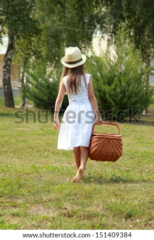 Cute little girl going on the picnic on sunny summer day - stock photo