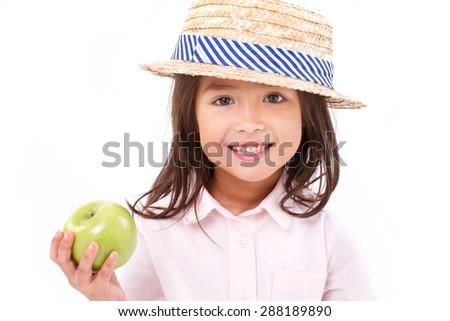 cute little girl, hand holding green apple - stock photo