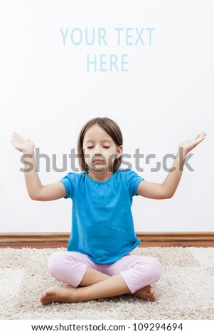 cute little girl have meditation on her room - stock photo