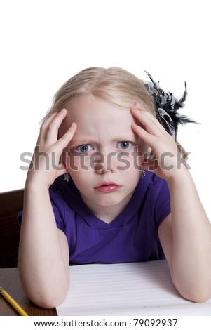 Cute Little Girl Having a Hard Time with Her Homework - stock photo