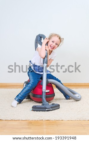 Cute little girl having fun during house cleaning. - stock photo