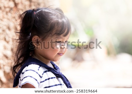 Cute little girl having fun in the park - stock photo