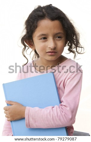 cute little girl holding a book