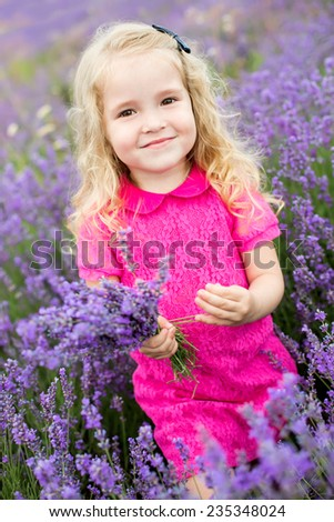 cute little girl holding a bouquet of lavender - stock photo