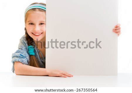 cute little girl holding a white board with space for text - stock photo