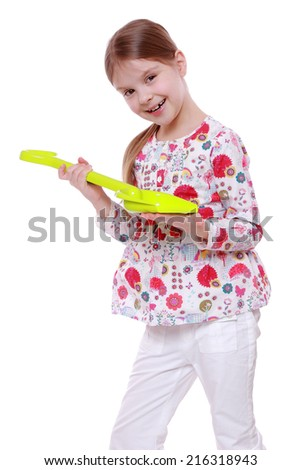 Cute little girl holding children paddle