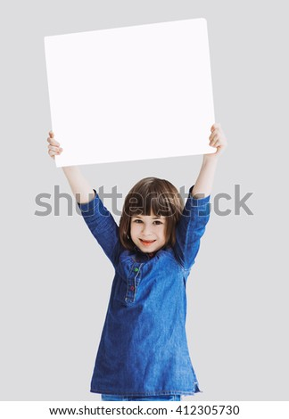 Cute little girl holding sign isolated on neutral background - stock photo