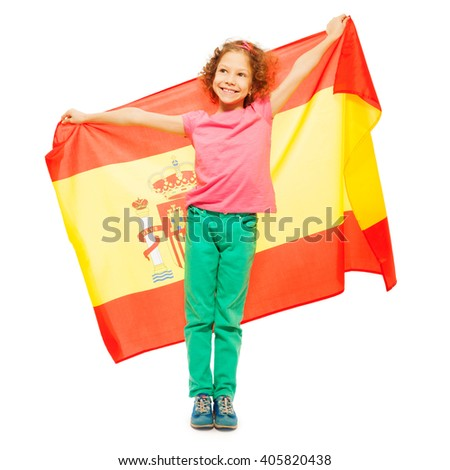Cute little girl holding Spanish flag behind her