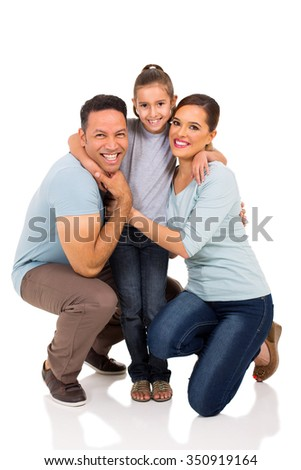 cute little girl hugging her parents on white background - stock photo