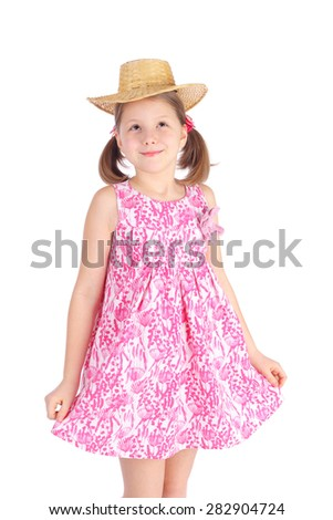 cute little girl in a pink summer dress and straw hat - stock photo