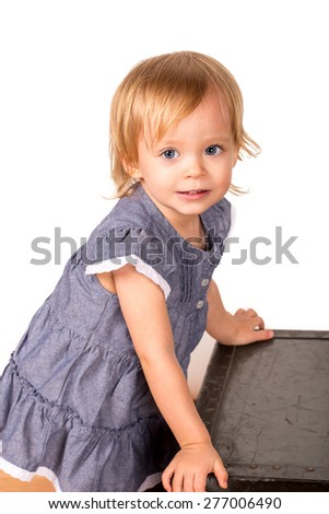 Cute little girl in a studio with white background - stock photo