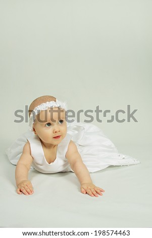 Cute little girl in a white dress.