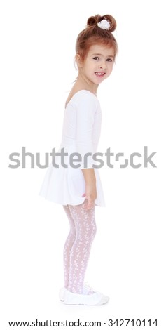 Cute little girl in a White sports leotard and white stockings stands sideways to the camera - Isolated on white background - stock photo
