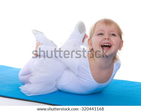 Cute little girl in a White sports swimsuit lies on the Mat and makes a complicated exercise-Isolated on white background - stock photo
