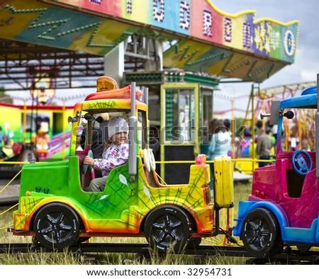 Cute little girl in amusement park - stock photo